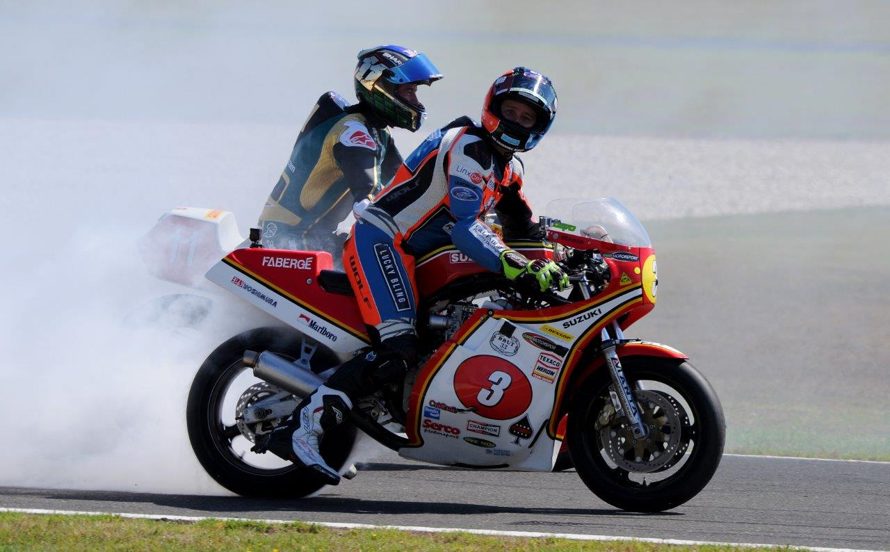 Dave Johnson smokes it up on his Suzuki XR69 after winning the Ken Wootton trophy, Troy Corser to his left Image Russell Colvin